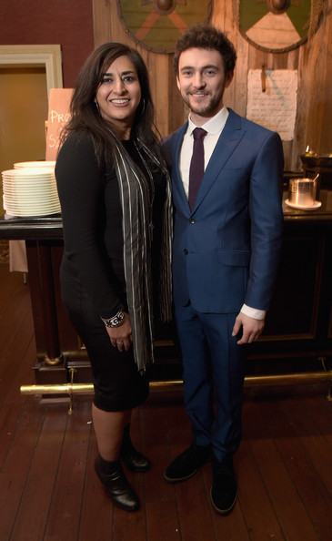 President, Television Group and Digital, MGM Studios, Roma Khanna (L) and actor George Blagden attend the JAN 2015 TCA History Vikings Party on January 9, 2015 in Pasadena, California.
