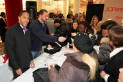"""New York Pro Athletes (L) Terrell Thomas and (2nd L) Shaun O'Hara stuff bags during JOE Joseph Abboud, JCPenney, and IAVA celebrate """"Welcome Home Joe"""" with """"Combat to Career"""" an event to benefit veterans at JCPenney on December 7, 2010 in New York City."""