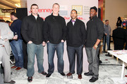 """(L-R) New York Pro Athletes Bear Pascoe, Kevin Boss, Terrell Thomas and Deon Grant pose during JOE Joseph Abboud, JCPenney, and IAVA celebrate """"Welcome Home Joe"""" with """"Combat to Career"""" an event to benefit veterans at JCPenney on December 7, 2010 in New York City."""