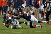 Charles Tillman #33 of the Chicago Bears takes down Allen Hurns #88 of the Jacksonville Jaguars during a preseason game at Soldier Field on August 14, 2014 in Chicago, Illinois.  The Bears defeated the Jaguars 20-19.