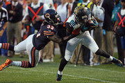 Charles Tillman #33 of the Chicago Bears tackles Allen Hurns #88 of the Jacksonville Jaguars during the second quarter of a preseason game at Soldier Field on August 14, 2014 in Chicago, Illinois.