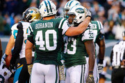 Chris Ivory #33 of the New York Jets is congratulated by his teammate Tommy Bohanon #40 after scoring a third quarter touchdown against the Jacksonville Jaguars Stadium on November 8, 2015 in East Rutherford, New Jersey.