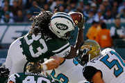 Chris Ivory #33 of the New York Jets dives past the defense and over the goaline for a first quarter touchdown against the Jacksonville Jaguars at MetLife Stadium on November 8, 2015 in East Rutherford, New Jersey.