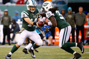 Chris Ivory #33 of the New York Jets takes the handoff from Ryan Fitzpatrick #14 against the Jacksonville Jaguars during the fourth quarter at MetLife Stadium on November 8, 2015 in East Rutherford, New Jersey. The New York Jets defeated the Jacksonville Jaguars 28-23.