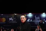 Chinese Director Zhang Yimou walks the red carpet ahead of the Ying (Shadow) and 2018 Jaeger-LeCoultre Glory To The Filmaker Award ceremony during the 75th Venice International Film Festival  at Sala Grande on September 6, 2018 in Venice, Italy.