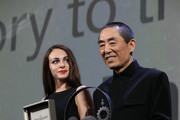 Chinese Director Zhang Yimou receives The Jaeger-LeCoultre Glory To The Filmmaker Award and Reverso engraved watch during the 75th Venice International Film Festival  at Sala Grande on September 6, 2018 in Venice, Italy.