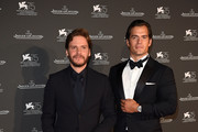 Daniel Bruhl and Henry Cavill arrive for the Jaeger-LeCoultre Gala Dinner during the 75th Venice International Film Festival at Arsenale on September 4, 2018 in Venice, Italy.