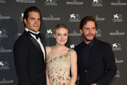(L-R) Henry Cavill, Dakota Fanning and Daniel Bruhl arrive for the Jaeger-LeCoultre Gala Dinner during the 75th Venice International Film Festival at Arsenale on September 4, 2018 in Venice, Italy.