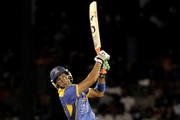 Shoaib Malik of Barbados Tridents hits a 6 against Jamaica Tallawahs during the Second Semi Final of the Caribbean Premier League between Barbados Tridents v Jamaica Tallawahs at Queens Park Oval on August 23, 2013 in Port of Spain, Trinidad and Tobago.