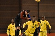 Chris Pontius #23 of USA and Je-Vaughn Watson #15 of Jamaica jump for a ball during the first half of a friendly match at Finley Stadium on February 3, 2017 in Chattanooga, Tennessee.
