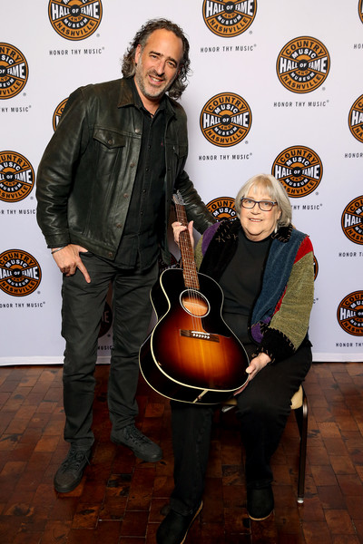 Country Music Hall of Fame and Museum Honors Bev Paul at 13th Annual Louise Scruggs Memorial Forum [string instrument,musical instrument,guitar,musician,plucked string instruments,acoustic guitar,bev paul,james jc curleigh,ceo,museum,nashville,tennessee,country music hall of fame and museum,louise scruggs memorial forum,gibson brands inc.,13th annual louise scruggs memorial forum,guitar,country music hall of fame and museum,public relations,musician,museum,m,socialite,flooring,hall of fame,public]