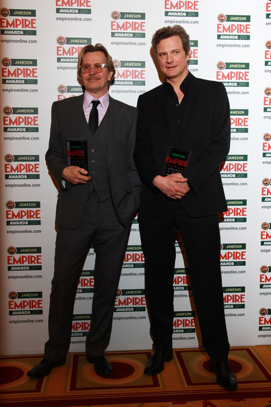 (UK TABLOID NEWSPAPERS OUT) Colin Firth and Gary Oldman pose with their Best Actor and Empire Icon awards in the press room at the Jameson Empire Awards 2011 held at Grosvenor House on March 27, 2011 in London, England.