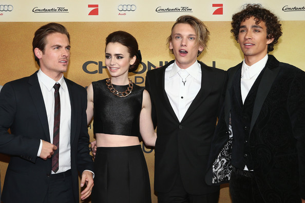Jamie Campbell Bower (L-R) Actors Kevin Zegers, Lily Collins, Jamie Campbell Bower and Robert Sheehan arrive for the 'The Mortal Instruments: City of Bones' (Chroniken der Unterwelt) Germany premiere at Sony Centre on August 20, 2013 in Berlin, Germany.