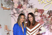 Louise Roe (R) poses with Jamie Chung as she celebrates her 42 Gold Collection at LaPeer Hotel on March 20, 2019 in West Hollywood, California.