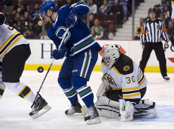 Jannik Hansen Jannik Hansen #36 of the Vancouver Canucks tries to redirect the puck past goalie Tim Thomas #30 of the Boston Bruins during the second period in NHL action on February 26, 2011 at Rogers Arena in Vancouver, British Columbia, Canada.