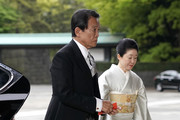 Japanese deputy prime minister and finance minister, Taro Aso (L), and his wife Chikako (R) arrive for Emperor Akihito's abdication ceremony at the Imperial Palace on April 30, 2019 in Tokyo, Japan. Japan's 85-year-old Emperor Akihito became the first Japanese emperor to abdicate in more than 200 years on Tuesday, ending his three-decade reign and making way for his son, Crown Prince Naruhito, to take the imperial throne. Naruhito, the elder of Akihito's two sons, will become emperor on Wednesday as the newly-named Reiwa era begins when the changeover takes place.