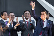 Japan's Prime Minister Shinzo Abe (R) waves as  Deputy Prime Minister and Finance Minister Taro Aso (L) claps during a campaign rally for the Liberal Democratic Party (LDP) presidential election in the Akihabara area on September 19, 2018 in Tokyo, Japan. The LDP presidential election will be held by the party members on September 20.