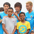 Yasuhito Endo Keisuke Honda Photos - Shinji Okazaki, Yasuhito Endo and Keisuke Honda smiles as they pose for pictures with children from the local area during a Japan training session at North Greenwood Recreation & Aquatic Complex on June 3, 2014 in Clearwater, Florida. - Japan Training Session