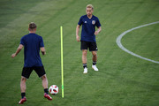 Keisuke Honda (L) and Yuto Nagatomo of Japan  in action duting the Japan training ahead of the 2018 FIFA World Cup Round of 16 match against Belgium at Rostov Arena on July 1, 2018 in Rostov-on-Don, Russia.