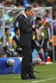 Paul Le Guen head coach of Cameroon looks at his watch during the 2010 FIFA World Cup South Africa Group E match between Japan and Cameroon at the Free State Stadium on June 14, 2010 in Mangaung/Bloemfontein, South Africa.