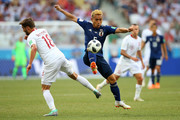 Yuto Nagatomo of Japan competes for the ball with Bartosz Bereszynski of Poland during the 2018 FIFA World Cup Russia group H match between Japan and Poland at Volgograd Arena on June 28, 2018 in Volgograd, Russia.