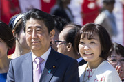 Japan's Prime Minister Shinzo Abe (L) and his wife Akie (R) pose for a photograph during the cherry blossom viewing party at the Shinjuku Gyoen National Garden on April 13, 2019 in Tokyo, Japan.