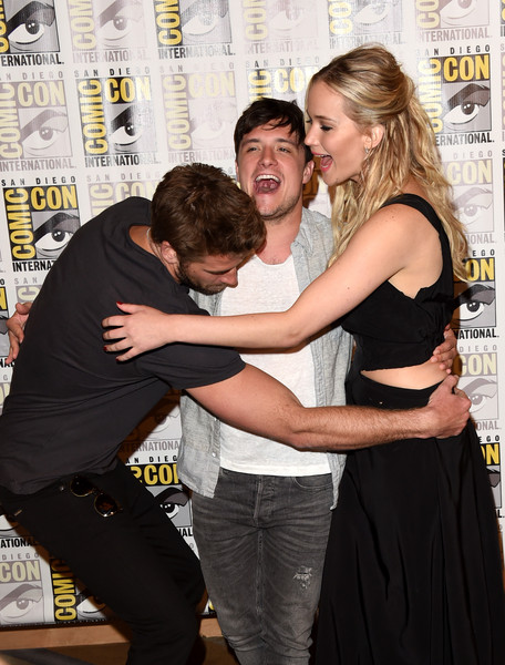 Comic-Con International 2015 - Lionsgate Press Room [press room,the hunger games: mockingjay - part 2,flooring,girl,interaction,fun,product,carpet,event,smile,actors,liam hemsworth,josh hutcherson,jennifer lawrence,l-r,press room,lionsgate,comic-con international 2015]