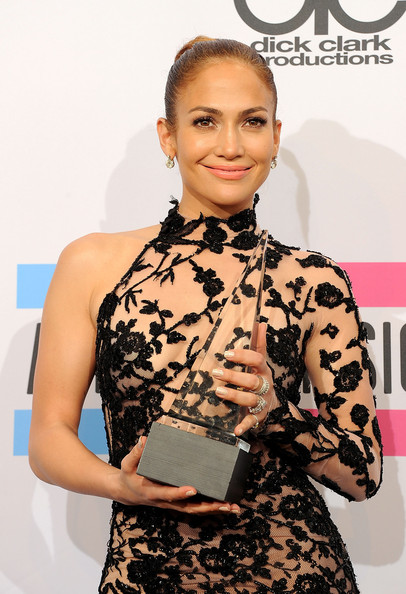 Jennifer Lopez Singer Jennifer Lopez, winner of Favorite Latin Artist Award, poses in the press room at the 2011 American Music Awards held at Nokia Theatre L.A. LIVE on November 20, 2011 in Los Angeles, California.