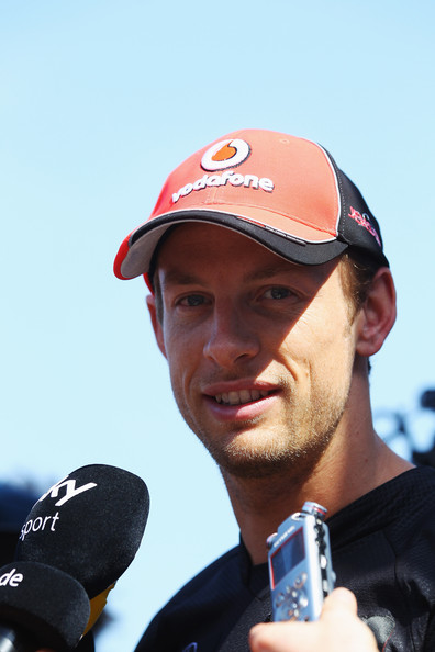 Jenson Button Jenson Button of Great Britain and McLaren is interviewed by the media in the paddock during previews to the European Formula One Grand Prix at the Valencia Street Circuit on July 23, 2011, in Valencia, Spain.
