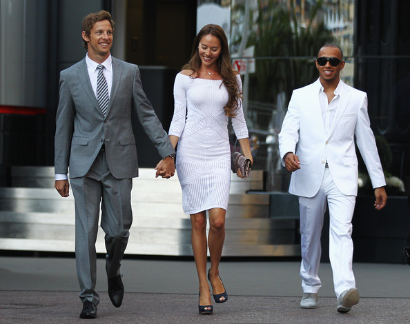 Jenson Button (L-R) Jenson Button of Great Britain and McLaren, his girlfriend Jessica Michibata and Lewis Hamilton of Great Britain and McLaren leave the paddock for the evening following previews to the Monaco Formula One Grand Prix at the Monte Carlo Circuit on May 27, 2011 in Monte Carlo, Monaco.