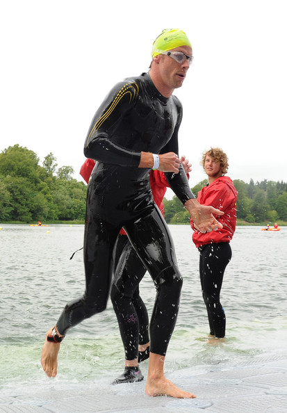 Jenson Button Jenson Button emerges from the water during the GE Blenheim Triathlon at Blenheim Palace on June 5, 2011 in Woodstock, England.