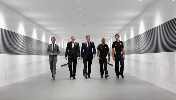 Jenson Button British Prime Minister David Cameron (C) is joined by Ron Dennis (2nd L), the Executive Chairman of McLaren Automotive, racing drivers Lewis Hamilton (2nd R) and Jenson Button (R) and cyclist Mark Cavendish (L) during a visit to the McLaren Technology Centre on November 17, 2011 in Woking, England. Today Mr Cameron helped launch the 1 million GBP 'Queen Elizabeth Prize for Engineering' at London's Science Museum which is to be awarded every two years for a major engineering advance that leads to significant international public benefit.