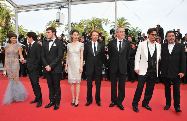"""Pirates of the Caribbean: On Stranger Tides"" Premiere - 64th Annual Cannes Film Festival [pirates of the caribbean: on stranger tides,red carpet,carpet,event,suit,premiere,flooring,formal wear,tuxedo,ceremony,smile,penelope cruz,jerry bruckheimer,rob marshall,actors,astrid berges-frisbey,sam claflin,geoffrey rush,l-r,cannes film festival]"