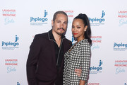 Marco Perego (L) and Zoe Saldana-Perego arrive at Jhpiego's Los Angeles Gala - Laughter Is The Best Medicine on April 29, 2019 in Beverly Hills, California.