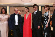(L-R) Actress Misty Upham, Director Arnaud Desplechin, guest, actor Benicio Del Toro, actress Gina McKee and writer Kent Jones attend the 'Jimmy P. (Psychotherapy Of A Plains Indian)' Premiere during the 66th Annual Cannes Film Festival at the Palais des Festivals on May 18, 2013 in Cannes, France.