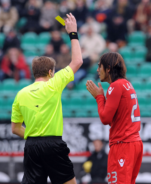 AC Siena v Cagliari Calcio - Serie A [referee,player,sports,penalty card,official,team sport,sports equipment,championship,sport venue,serie a,cagliari calcio,ac siena,mps arena stadium,action,siena,italy,referee,dino tommasi,joaquin larrivey of cagliari]