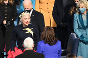 Singer Lady Gaga (L) greets US Vice President-elect Kamala Harris as she arrives during the 59th Presidential Inauguration at the U.S. Capitol on January 20, 2021 in Washington, DC. During today's inauguration ceremony Joe Biden becomes the 46th president of the United States.