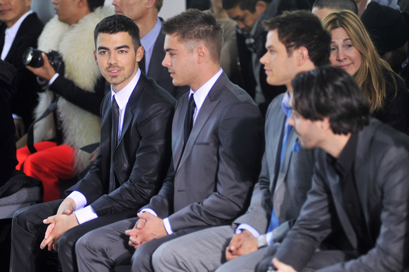 Joe Jonas Musician Joe Jonas, actors Zac Efron and Kellan Lutz attend the Calvin Klein Men's Collection Fall 2011 fashion show during Mercedes-Benz Fashion Week at 205 West 39th Street on February 13, 2011 in New York City.