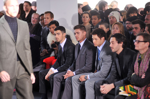 Joe Jonas (L-R) Musician Joe Jonas, actors Zac Efron, Kellan Lutz and Jack Huston attend the Calvin Klein Men's Collection Fall 2011 fashion show during Mercedes-Benz Fashion Week at 205 West 39th Street on February 13, 2011 in New York City.