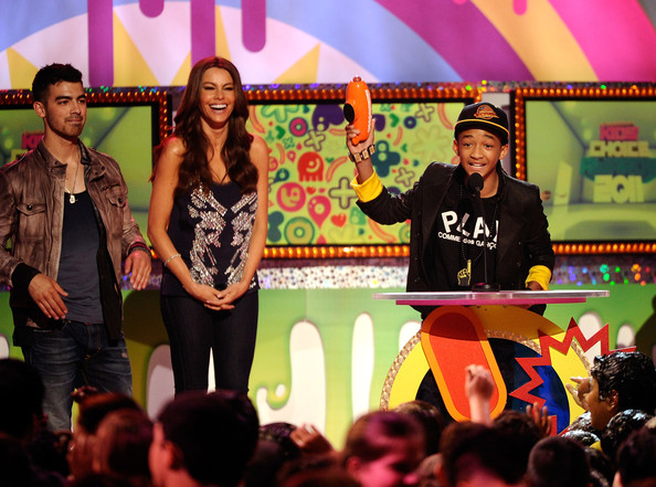 Joe Jonas Actor Jaden Smith (R) accepts the award for Favorite Movie from singer Joe Jonas (L) and actress Sofia Vergara onstage during Nickelodeon's 24th Annual Kids' Choice Awards at Galen Center on April 2, 2011 in Los Angeles, California.