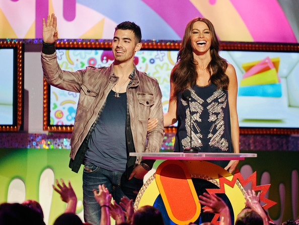Joe Jonas Singer Joe Jonas and Actress Sofia Vergara stand onstage during Nickelodeon's 24th Annual Kids' Choice Awards at Galen Center on April 2, 2011 in Los Angeles, California.