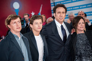 (L-R) US film director David Gordon, US actors Tye Sheridan, Nicolas Cage and US producer Lisa Muskat arrive at the premiere of the movie 'Joe' during the 39th Deauville American film festival on September 2, 2013 in Deauville, France.