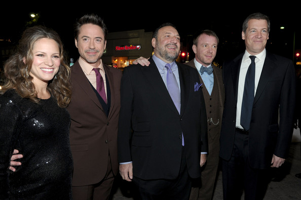 "Premiere Of Warner Bros. Pictures' ""Sherlock Holmes: A Game Of Shadows"" - Red Carpet [sherlock holmes: a game of shadows,suit,event,formal wear,tuxedo,night,smile,robert downey jr.,susan downey,joel silver,guy ritchie,lionel wigram,l-r,warner bros. pictures,red carpet,premiere]"