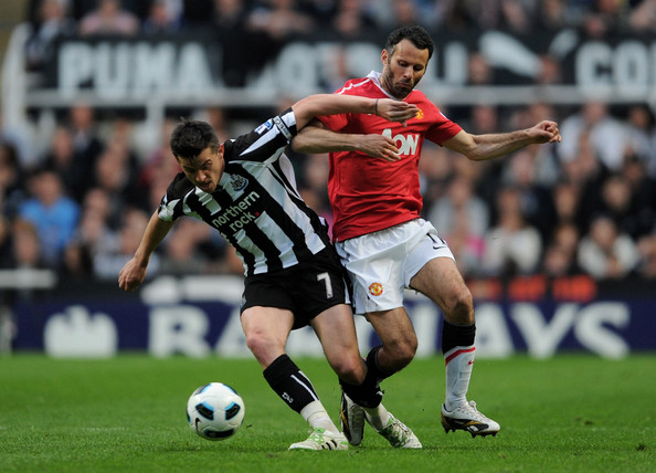 Joey Barton Joey Barton of Newcastle United battles for the ball with Ryan Giggs of Manchester United during the Barclays Premier League match between Newcastle United and Manchester United at St James' Park on April 19, 2011 in Newcastle, England.