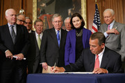 Speaker of the House John Boehner (R-OH) signs the Clay Hunt Suicide Prevention for American Veterans Act with (L-R) Sen. John McCain (R-AZ), Rep. Timothy Walz (D-MN), House Veterans Affairs Committee Chairman Jeff Miller (R-FL), Senate Armed Services Committee Chairman Johnny Isakson (R-GA), Senate Majority Leader Mitch McConnell (R-KY), House Minority Whip Steny Hoyer (D-MD), Clay Hunt's mother Susan Selke and Sen. Orrin Hatch (R-UT) in the Rayburn Room at the U.S. Capitol February 10, 2015 in Washington, DC. A decorated combat veteran of Iraq and Afghanistan, Clay Hunt became a prominent advocate for troops suffering from post-traumatic stress disorder after leaving the Marine Corps and later killed himself in 2011.
