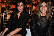 Julia Restoin Roitfeld and Carine Roitfeld attend the John Galliano Ready to Wear Spring/Summer 2011 show during Paris Fashion Week at Opera Comique on October 3, 2010 in Paris, France.