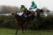 Don't Push It ridden by A.P McCoy (6) clears the last fence alongside Black Apalachi ridden by Denis O'Regan (4) on their way to victory in The John Smith's Grand National Steeple Chase at Aintree Racecourse on April 10, 2010 in Liverpool, England.