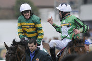 Don't Push It and Tony McCoy (L) are congratulated by jockey Davy Russell after winning the John Smith's Grand National Steeple Chase at Aintree racecourse on April 10, 2010 in Liverpool, England.