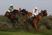 The Midnight Club ridden by Ruby Walsh (11) clears 'The Chair' ahead of Don't Push It ridden by A.P McCoy (1) during The John Smith's Grand National Steeple Chase at Aintree Racecourse on April 9, 2011 in Liverpool, England.