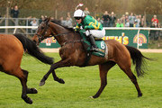 Tony McCoy jumps Becher's Brook as he rides Don't Push It to victory during The John Smith's Grand National Steeple Chase at Aintree racecourse on April 10, 2010 in Liverpool, England.
